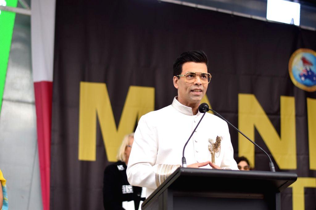 Filmmaker Karan Johar addresses after hoisting the Indian tricolour at Federation Square in Melbourne, Australia. Desis' from across the city gathered at Federation Square here on Saturday to see Karan hoisting the Indian tricolour. This annual honou - Karan Johar