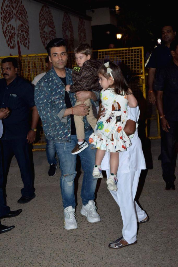 Filmmaker Karan Johar along with his childrens Roohi Johar and Yash Johar attend the birthday party of Aaradhya Bachchan, the daughter of actors Abhishek Bachchan and Aishwarya Rai Bachchan, ... - Karan Johar, Abhishek Bachchan, Aishwarya Rai Bachchan and Aaradhya Bachchan