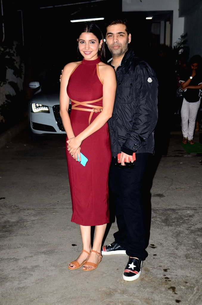 Filmmaker Karan Johar and actress Anushka Sharma during the special screening of the movie `Bombay Velvet` on Anushka Sharma`s B`day in Mumbai on 1st May, 2015. Film Bombay Velvet is all set to ... - Karan Johar