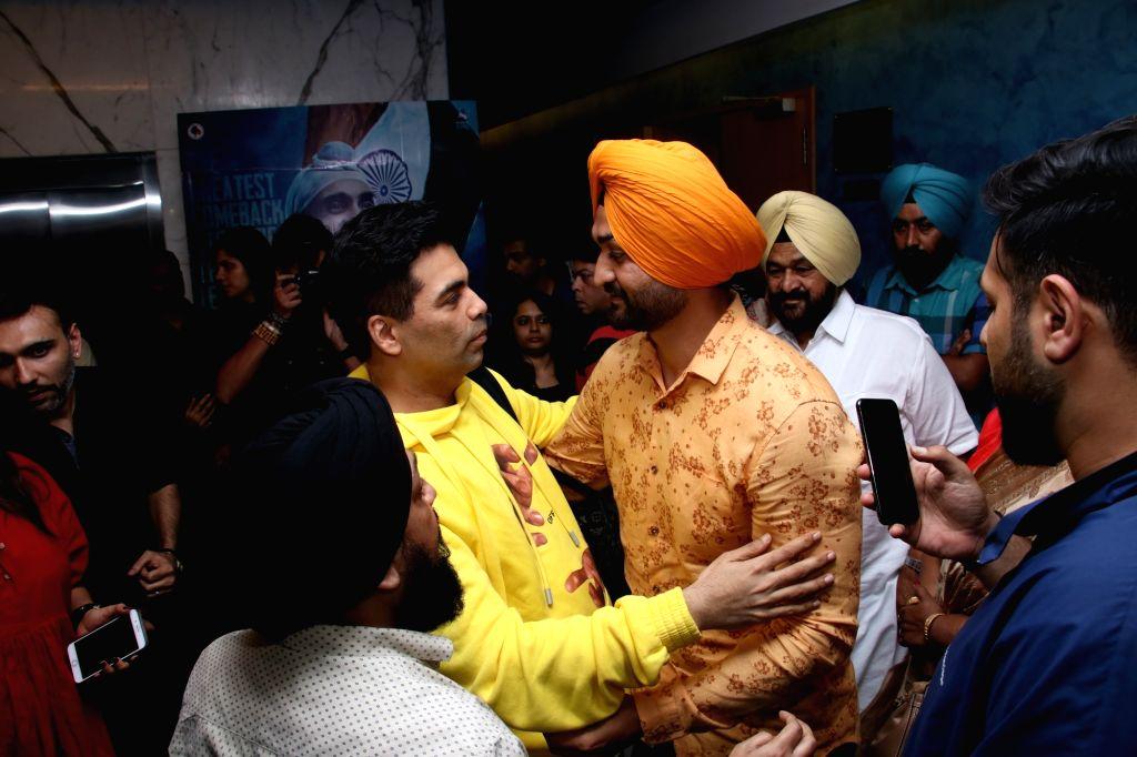 """Filmmaker Karan Johar and former hockey player Sandeep Singh at the screening of """"Soorma"""" in Mumbai on July 13, 2018. - Karan Johar and Sandeep Singh"""