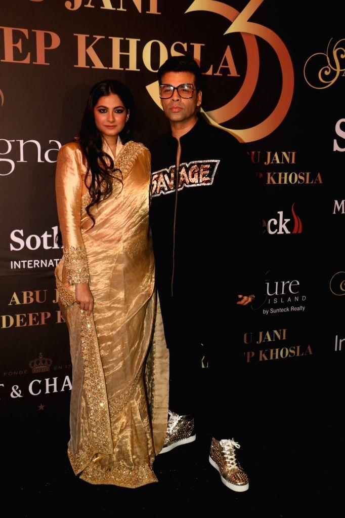 Filmmaker Karan Johar and producer Rhea Kapoor at fashion designers Abu Jani-Sandeep Khosla's fashion show in Mumbai, on Sep 5, 2019. - Karan Johar and Kapoor