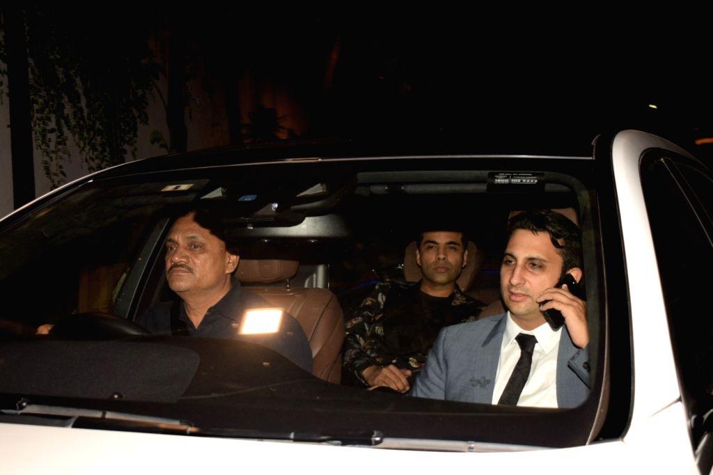 Filmmaker Karan Johar arrives to attend designers Abu Jani and Sandeep Khosla's party in Mumbai on Dec 9, 2017. - Karan Johar