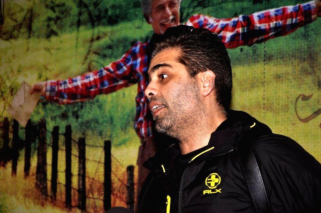 Filmmaker Karan Johar during the screening of film Finding Fanny, in Mumbai, on Sep. 01, 2014. - Karan Johar