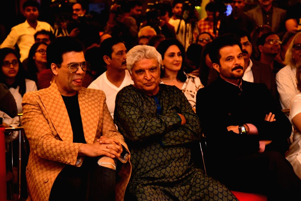 "Filmmaker Karan Johar, poet, lyricist and screenwriter Javed Akhtar and actor Anil Kapoor at the launch of journalist and author Khalid Mohamed's book ""The Aladia Sisters"" in Mumbai ... - Karan Johar and Kapoor"