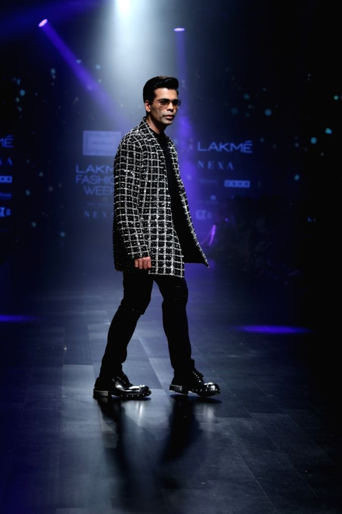 Filmmaker Karan Johar walks the ramp in fashion designer Shehla Khan's creation during Lakme Fashion Week (LFW) Summer/Resort 2019 in Mumbai, on Feb 3, 2019. - Karan Johar and Shehla Khan