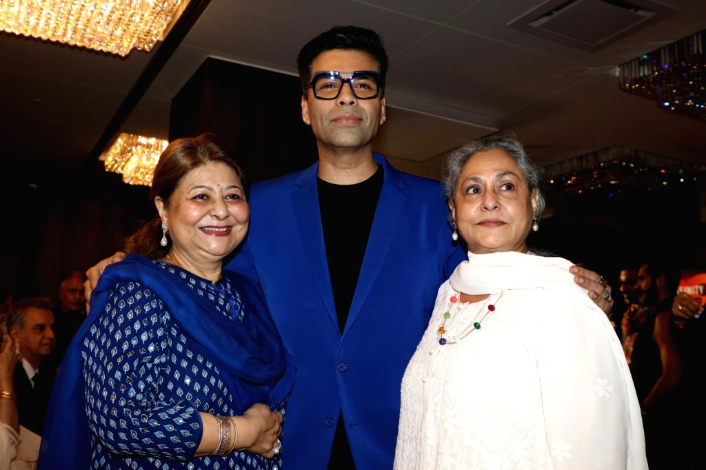 "Filmmaker Karan Johar with actress-turned-politician Jaya Bachchan at the launch of musicians Amaan Ali Bangash, Ayaan Ali Bangash and Karsh Kale's music album ""Infinity"" in Mumbai ... - Karan Johar and Jaya Bachchan"