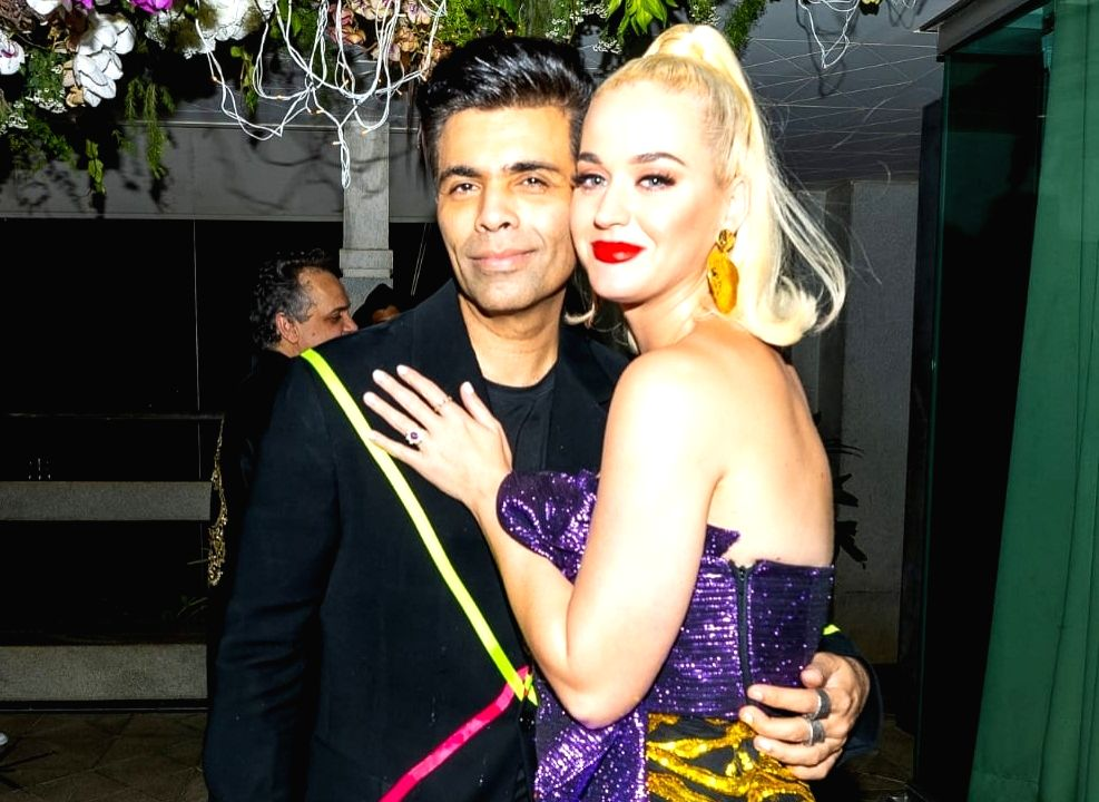 Filmmaker Karan Johar with pop singer Katy Perry at a party hosted by him for her at his residence. - Karan Johar