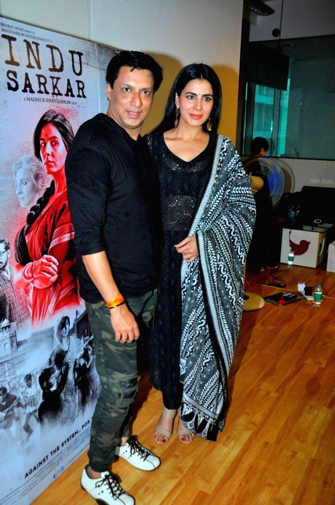 Filmmaker Madhur Bhandarkar and actress  Kirti Kulhari during the launch of Qawwali Chadhta Soorag from film Indu Sarkar, in Mumbai,on June 28, 2017. - Madhur Bhandarkar