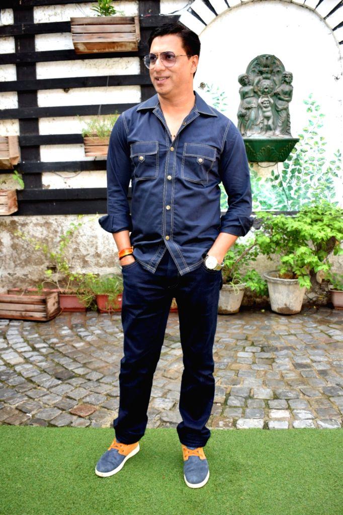 """Filmmaker Madhur Bhandarkar during a press conference to promote his upcoming film """"Indu Sarkar"""" in New Delhi on July 25, 2017. - Madhur Bhandarkar"""
