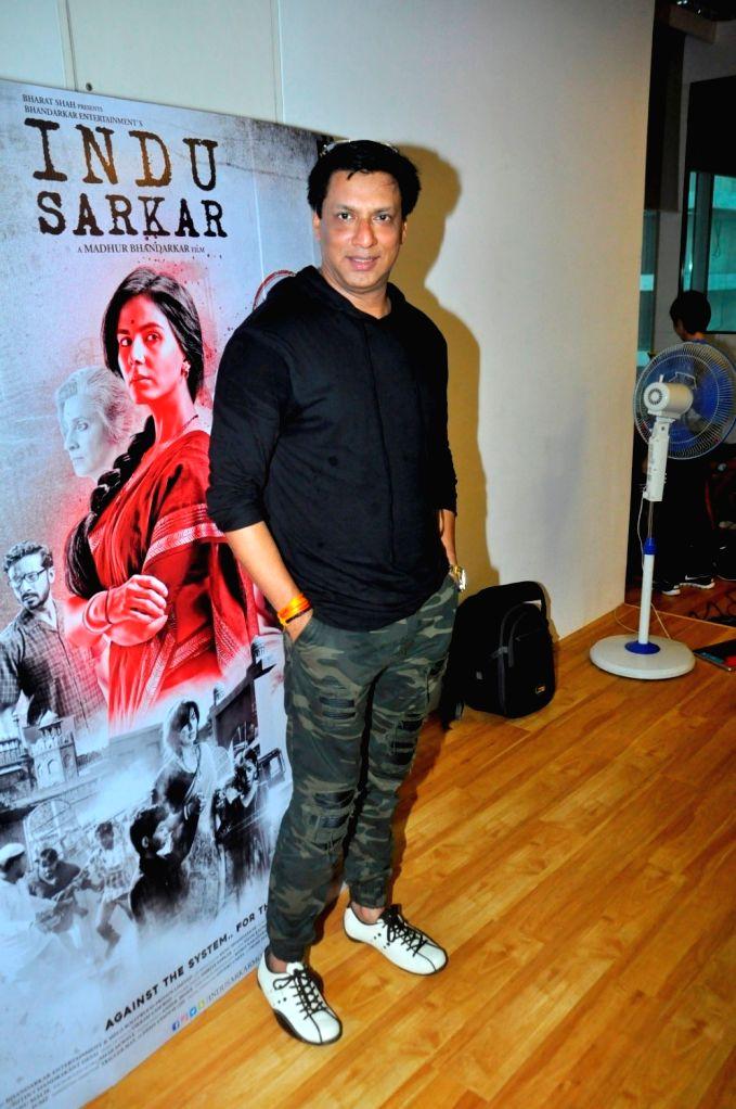Filmmaker Madhur Bhandarkar during the launch of Qawwali Chadhta Soorag from film Indu Sarkar, in Mumbai,on June 28, 2017. - Madhur Bhandarkar
