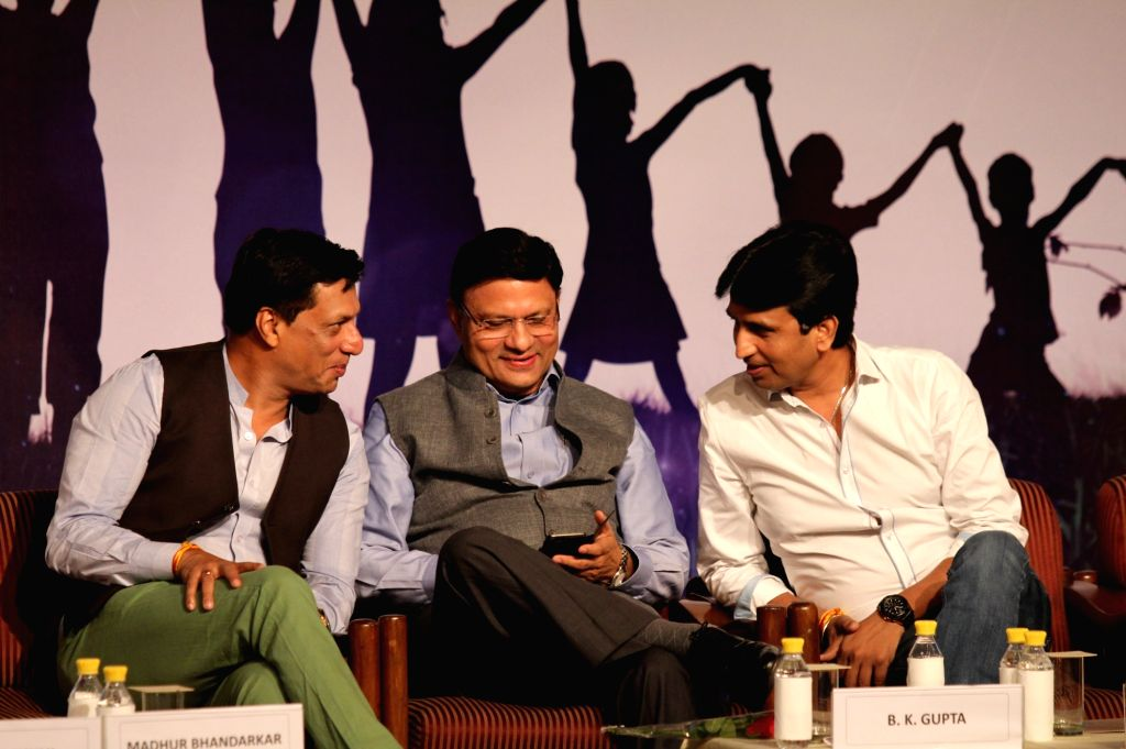 "Filmmaker Madhur Bhandarkar, IAS officer BK Gupta and AAP leader Kumar Vishwas during ""Unseen, Unheard - Innocent Prisoners of Conscience"" - a seminar in New Delhi, on Sept 18, 2016. - Madhur Bhandarkar"