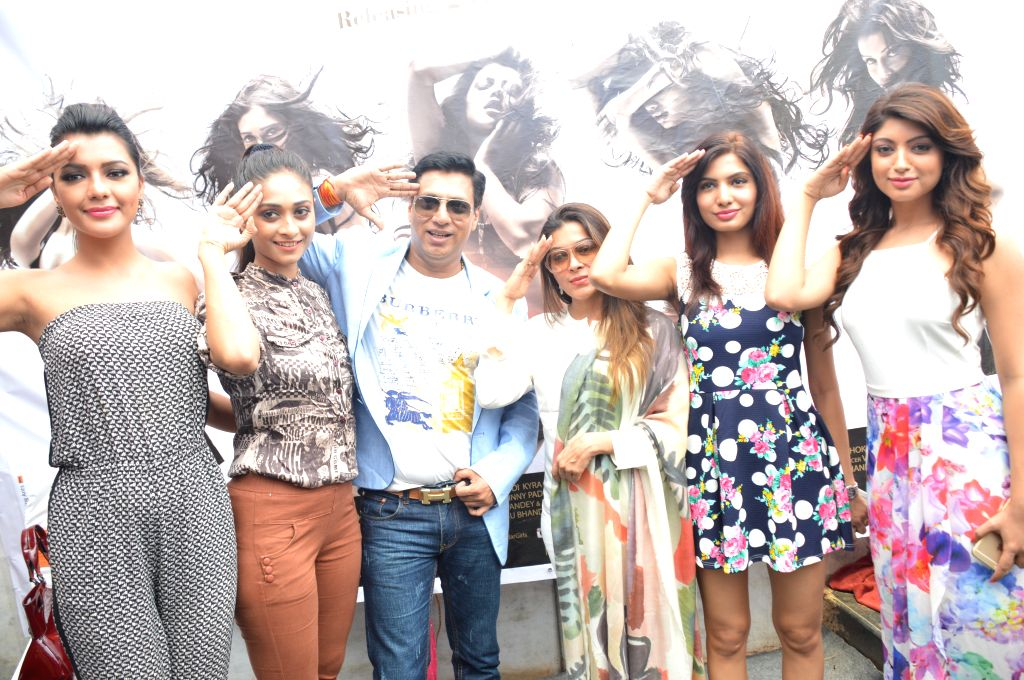 Filmmaker Madhur Bhandarkar with calendar girls during the opening of a new outlet of Shiva`s Salon in Mumbai.