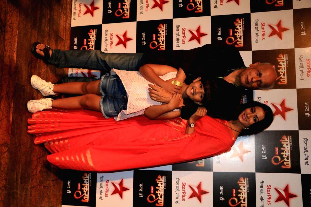 Filmmaker Mahesh Bhatt, actor Barkha Bisht and child artist Ashween during the launch of Star Plus new serial Naamkaran in Mumbai on Aug 23, 2016. - Mahesh Bhatt