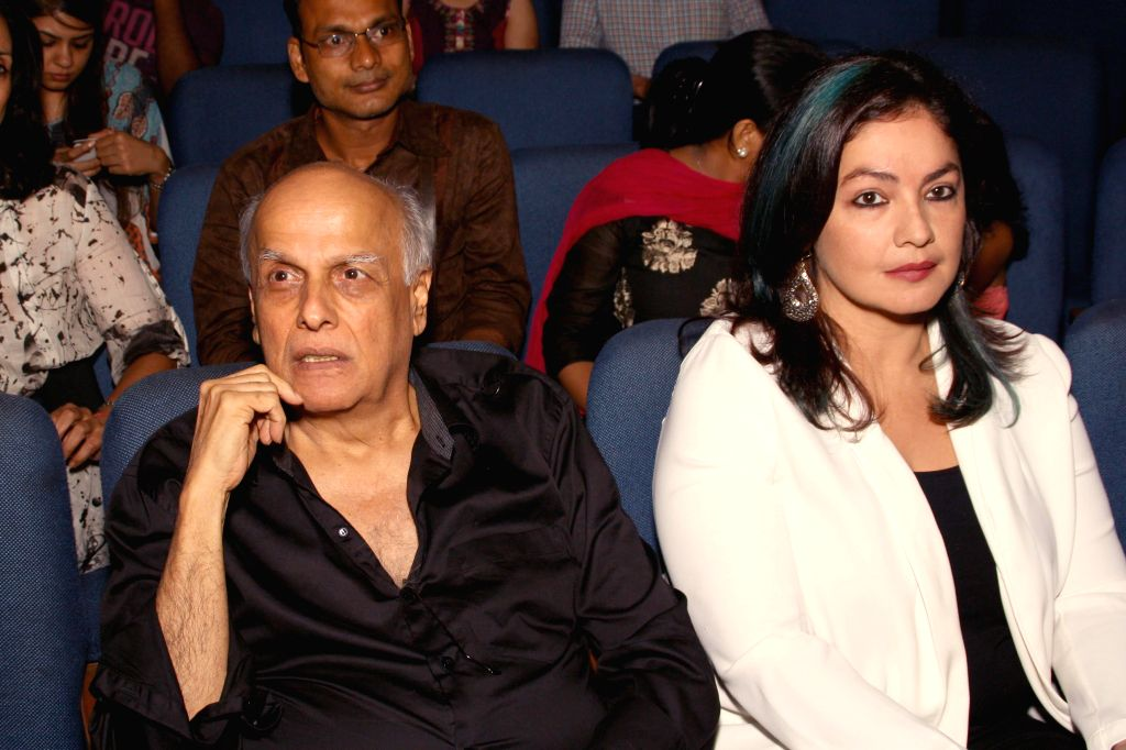 Filmmaker Mahesh Bhatt and actress Pooja Bhatt during a programme where theatrical adaptation of Mahesh Bhatt's film `Daddy` was staged in New Delhi on Aug 4, 2014. - Mahesh Bhatt