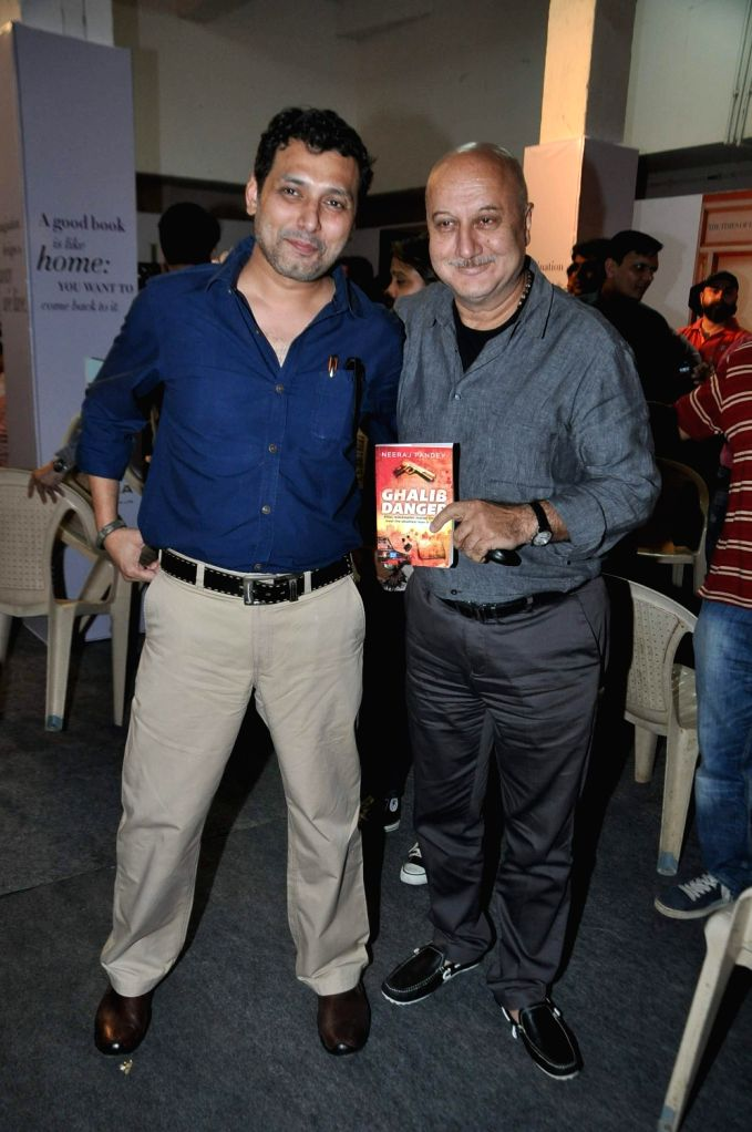 Filmmaker Neeraj Pandey and actor Anupam Kher during Neeraj's book launch Ghalib Danger at the Literary Carnival, a festival for author, film-makers, lyricists, foodies, fitness experts, money .. - Neeraj Pandey and Anupam Kher