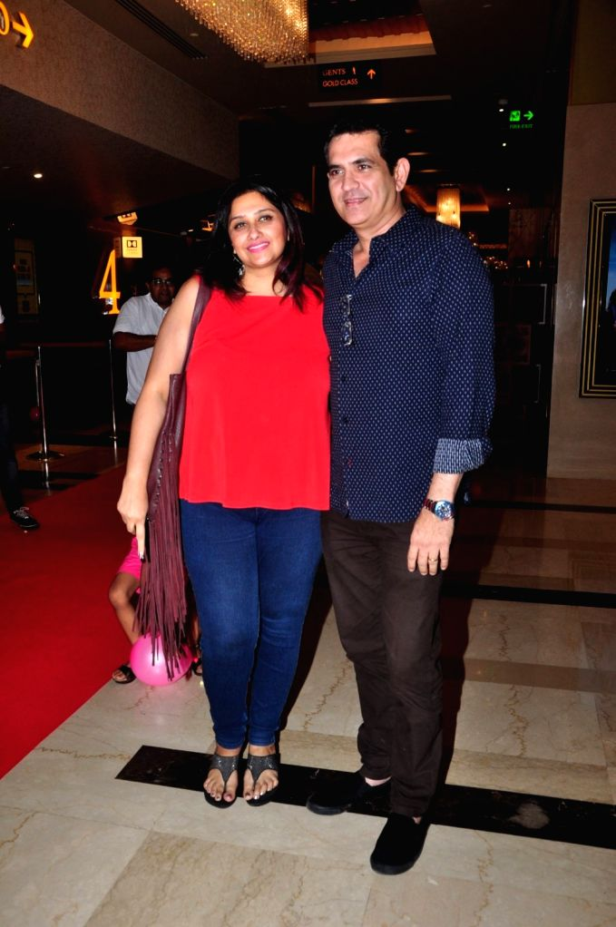 Filmmaker Omung Kumar along with his wife Vanita Omung Kumar during the premiere of film Days of Tafree, in Mumbai, on Sept 21, 2016. - Vanita Omung Kumar