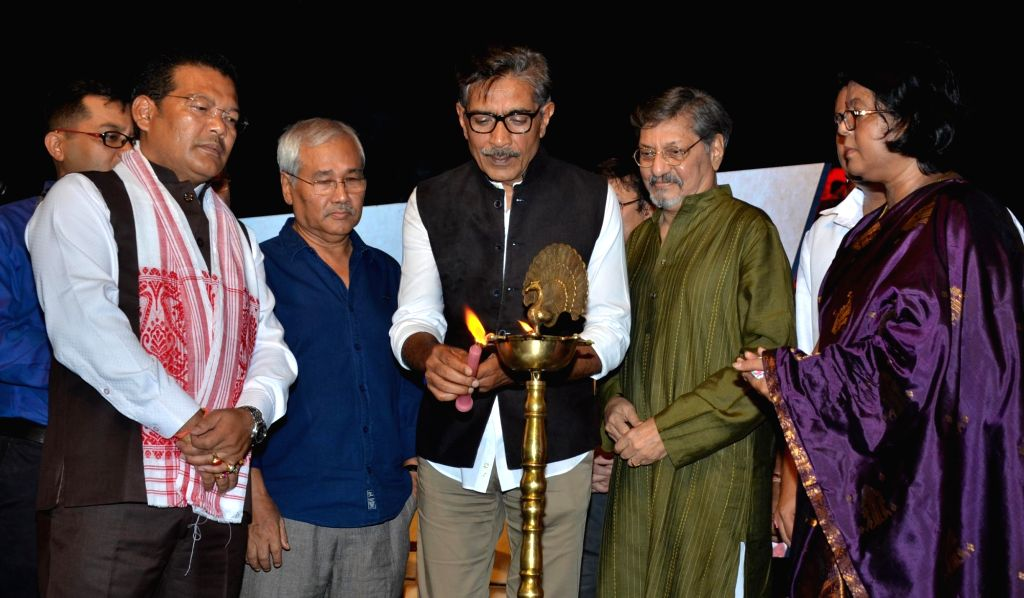 Filmmaker Prakash Jha lights the inaugural ceremony lamp of 7th Assam State Film Award and Film Festival 2018, at Srimanta Sankardev Kalakshetra International Auditorium, in Guwahati on ... - Prakash Jha and Naba Kumar Doley