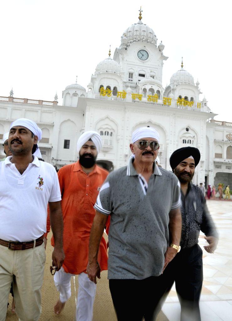 Filmmaker Rakesh Roshan pays obeisance at the Golden temple in Amritsar on Aug 21, 2017. - Rakesh Roshan