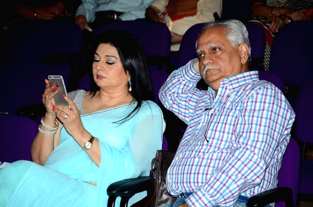 Filmmaker Ramesh Sippy along with his wife and actress Kiran Juneja during the celebration of 40 years of the film `Sholay` at a special function in Mumbai, on Aug 13, 2015.