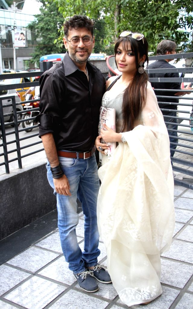"Filmmaker Riingo Banerjee and his wife and actress Rupsha Guha Banerjee during a press conference regarding their upcoming film ""Senapati'"" in Kolkata, on May 6, 2016. - Riingo Banerjee and Rupsha Guha Banerjee"