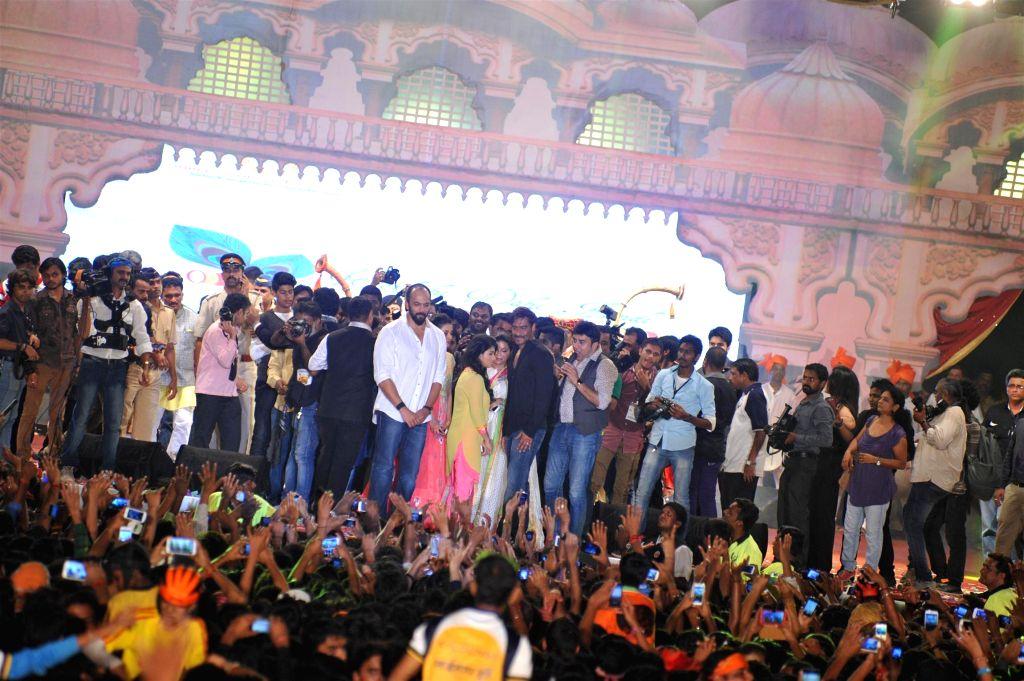 Filmmaker Rohit Shetty and actor Ajay Devgn during Dahi Handi 2014 celebrations organised by MNS leader Ram Kadam at Ghatkopar in Mumbai on Aug. 18, 2014. - Rohit Shetty and Ajay Devgn