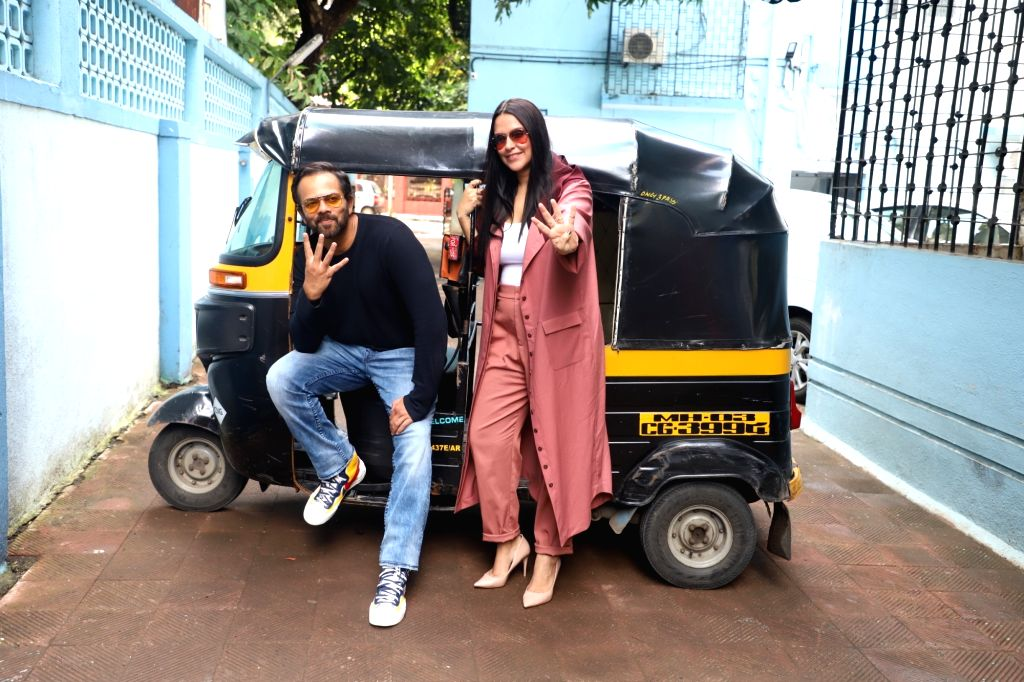 """Filmmaker Rohit Shetty with actress Neha Dhupia on the sets of her chat show """"#NoFilterNeha"""" in Mumbai on Nov 8, 2019. - Rohit Shetty and Neha Dhupia"""