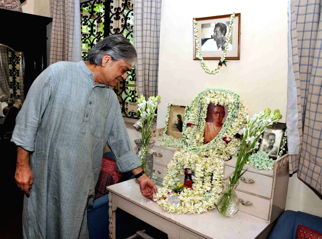 Filmmaker Sandip Ray pays tribute to his father Satyajit Ray on his birth anniversary at his residence in Kolkata on May 2, 2017. Satyajit Ray was the greatest filmmakers of the 20th century ... - Sandip Ray