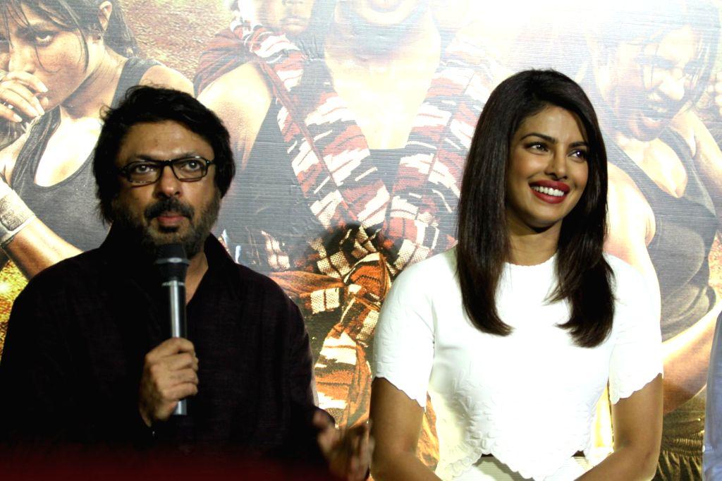 Filmmaker Sanjay Leela Bhansali and actor Priyanka Chopra during the unveiling of the trailer of film Mary Kom in Mumbai on July 23, 2014. - Sanjay Leela Bhansali and Priyanka Chopra