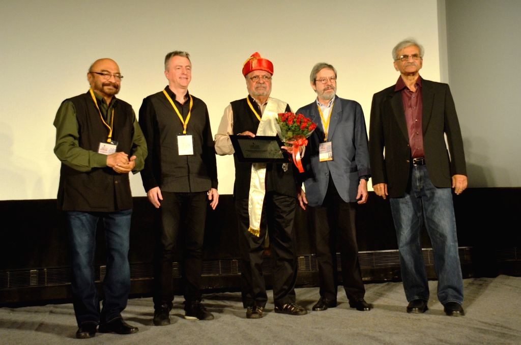 Filmmaker Shyam Benegal receives the `Lifetime Achievement Award for the outstanding contribution to Indian Cinema` during the inauguration ceremony of 14th Pune International Film Festival ... - Shyam Benegal and Jabbar Patel
