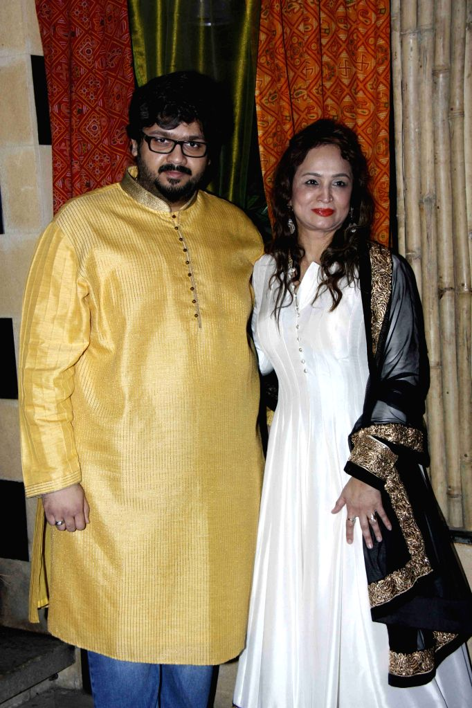 Filmmaker Smita Thackeray and her son Rahul Thackeray during her birthday party of in Mumbai on August 17,2015.