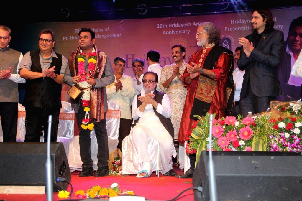 Filmmaker Subhash Ghai presents 5th Hridaynath award to Bollywood music composer A R Rahman on the birth anniversary of Pandit Hridaynath Mangeshkar at the award ceremony, in Mumbai on Oct ... - Subhash Ghai
