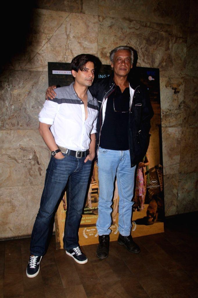 Filmmaker Sudhir Mishra and actor Rahul Bhat during the special screening of Punjabi film Chauthi Koot in Mumbai on Aug 1, 2016. - Sudhir Mishra