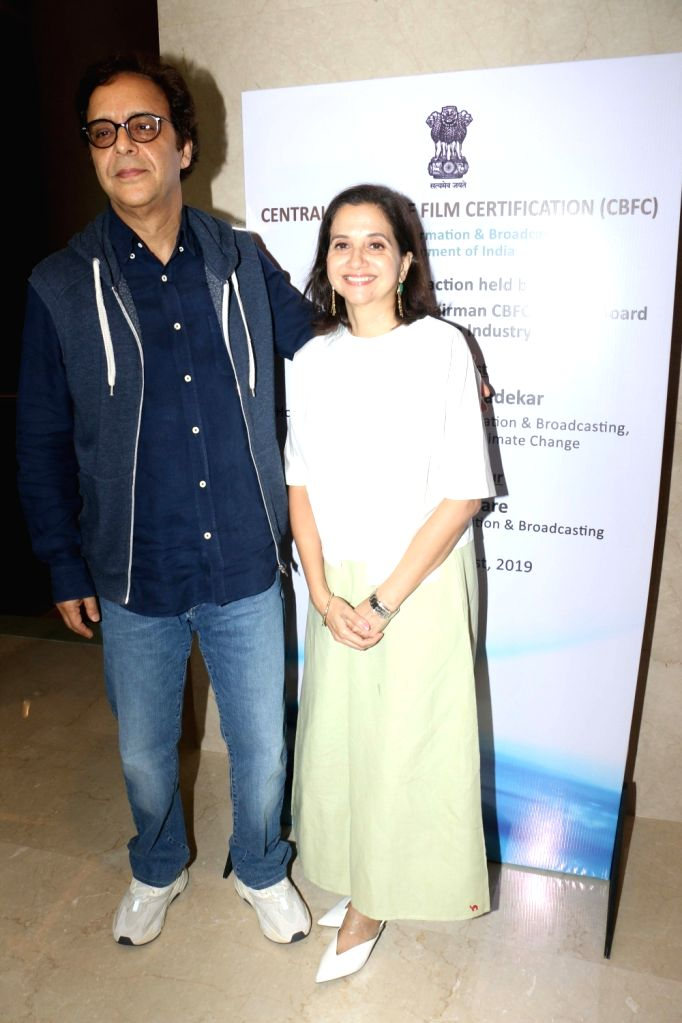 Filmmaker Vidhu Vinod Chopra with his wife Anupama Chopra during the launch of the new logo and certificate design of Central Board of Film Certification (CBFC) in Mumbai on Sept 1, 2019. - Vidhu Vinod Chopra and Anupama Chopra