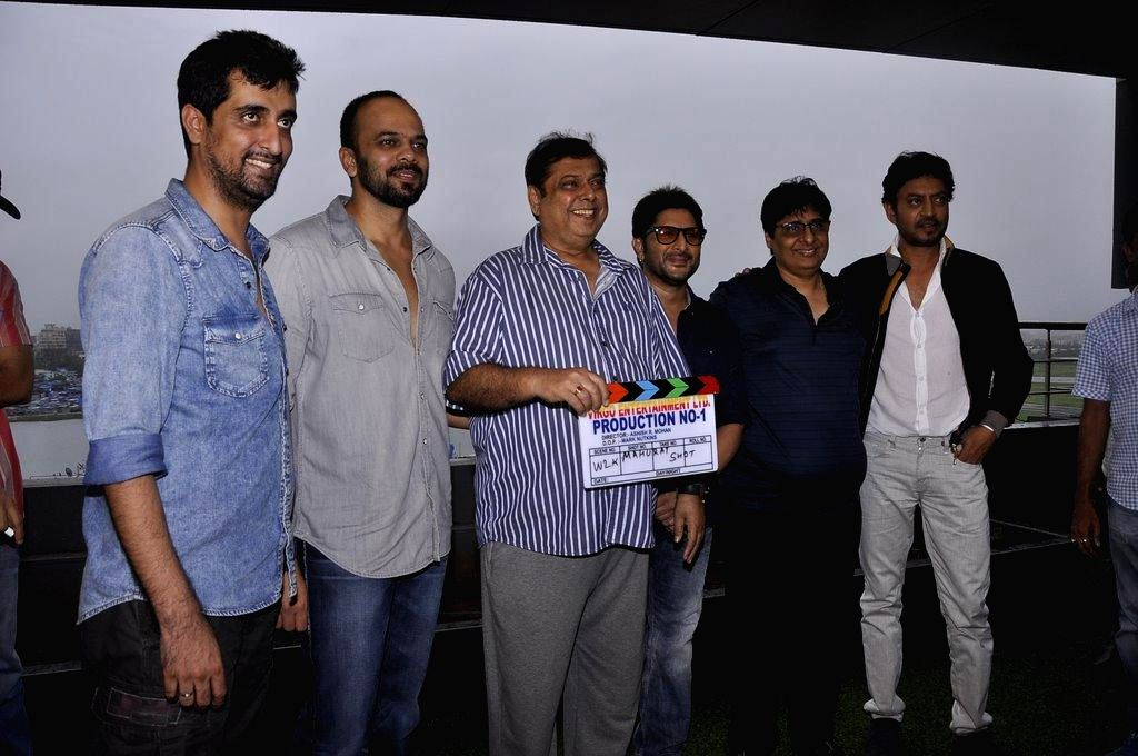 Filmmakers Ashish R Mohan, Rohit Shetty, David Dhawan, actor Arshad Warsi, filmmaker Vashu Bhagnani and actor Irrfan Khan during the muhurat of film Welcome to Karachi in Mumbai, on Sept. 5, 2014. - Arshad Warsi, Ashish R Mohan, Rohit Shetty, David Dhawan and Irrfan Khan