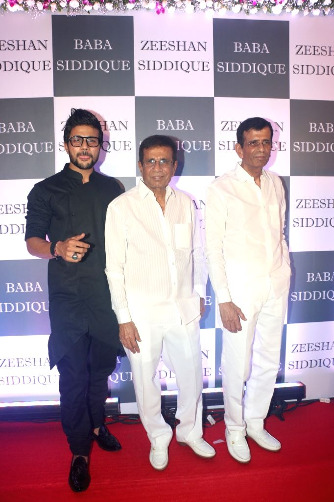 Filmmakers Mustan Burmawalla and Abbas Burmawalla with his son-actor Mustafa Burmawal at Congress leader Baba Siddique's Iftar party in Mumbai, on June 2, 2019. - Mustafa Burmawal, Mustan Burmawalla and Abbas Burmawalla
