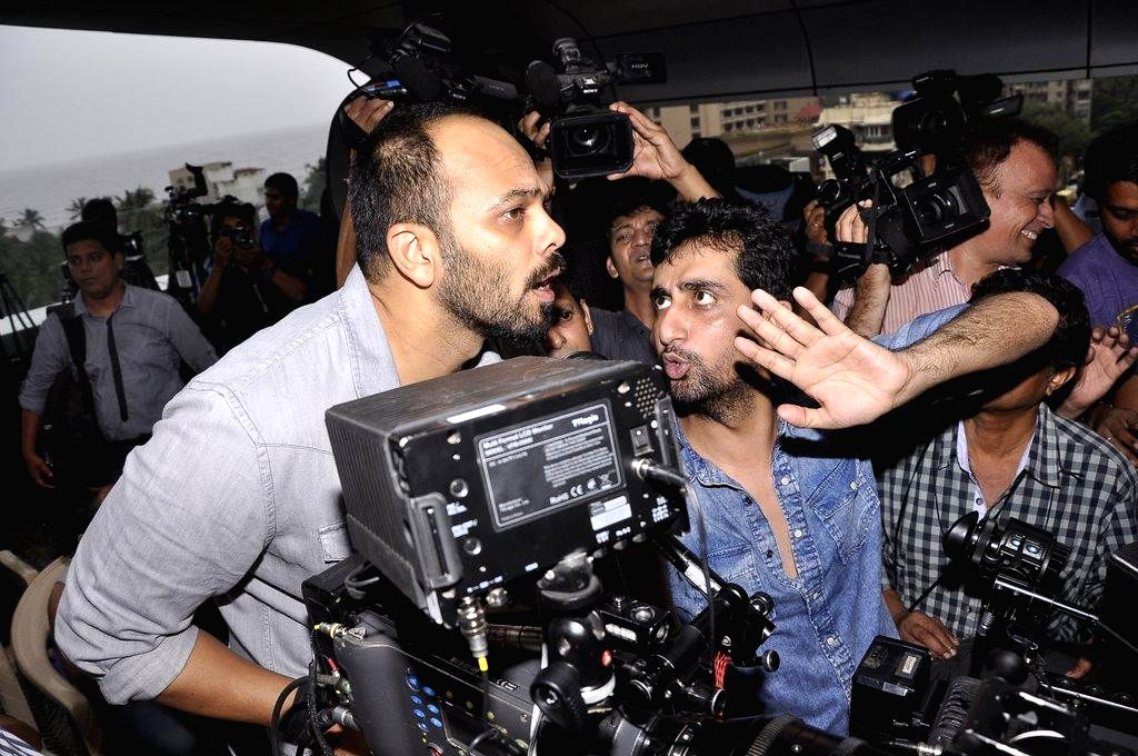 Filmmakers Rohit Shetty and Ashish R Mohan during the muhurat of film Welcome to Karachi in Mumbai, on Sept. 5, 2014. - Rohit Shetty and Ashish R Mohan