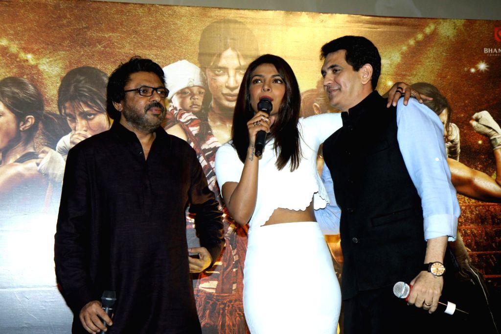 Filmmakers Sanjay Leela Bhansali, Omung Kumar and actor Priyanka Chopra during the unveiling of the trailer of film Mary Kom in Mumbai on July 23, 2014. - Priyanka Chopra, Sanjay Leela Bhansali and Omung Kumar
