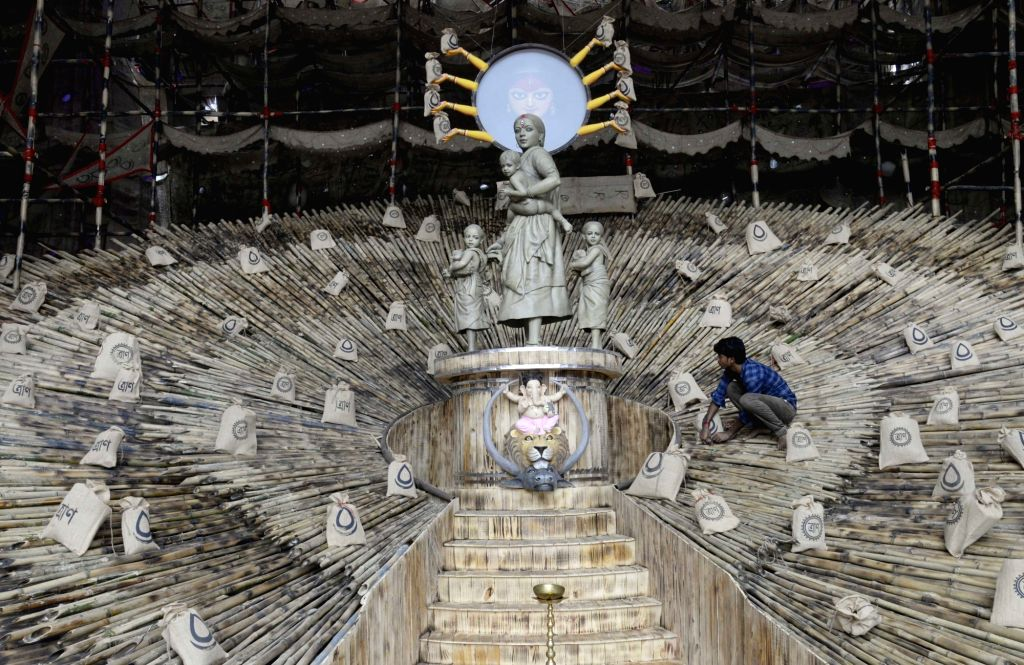 Final touches being given to a community Durga Puja pandal where the theme is 'Goddess Durga as a migrant labourer', at Barisha Club ahead of Durga Puja celebrations in Kolkata on Oct 16, ...