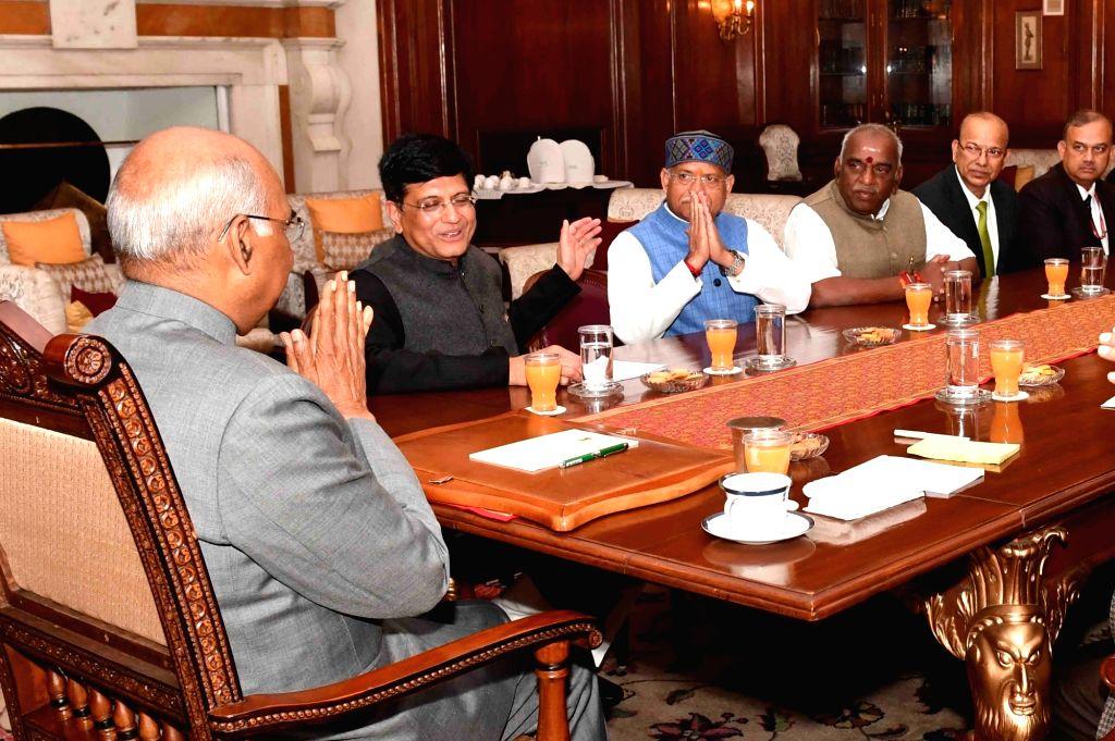 Finance Minister Piyush Goyal, Union Ministers of State for Finance Pon Radhakrishnan, Shiv Pratap Shukla and Finance Secretary Ajay Narayan Jha call on President Ram Nath Kovind ahead of ... - Piyush Goyal and Nath Kovind