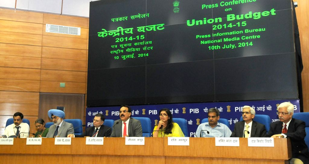 Finance Secretary, Dr. Arvind Mayaram with other Secretaries of the Finance Ministry during a press conference regarding General Budget 2014-15 in New Delhi on July 10, 2014. Also seen Principal ...