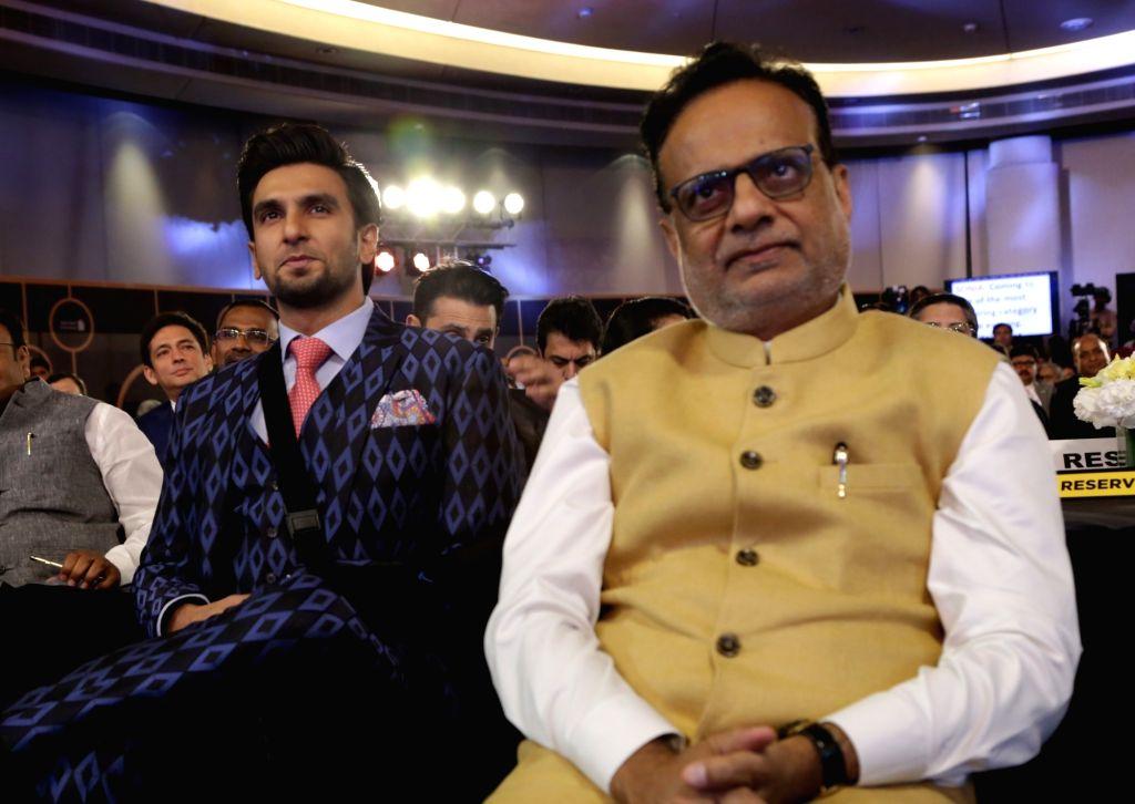 Finance Secretary Hasmukh Adhia and actor Ranveer Singh at India Business er Awards in New Delhion April 6, 2018. - Ranveer Singh