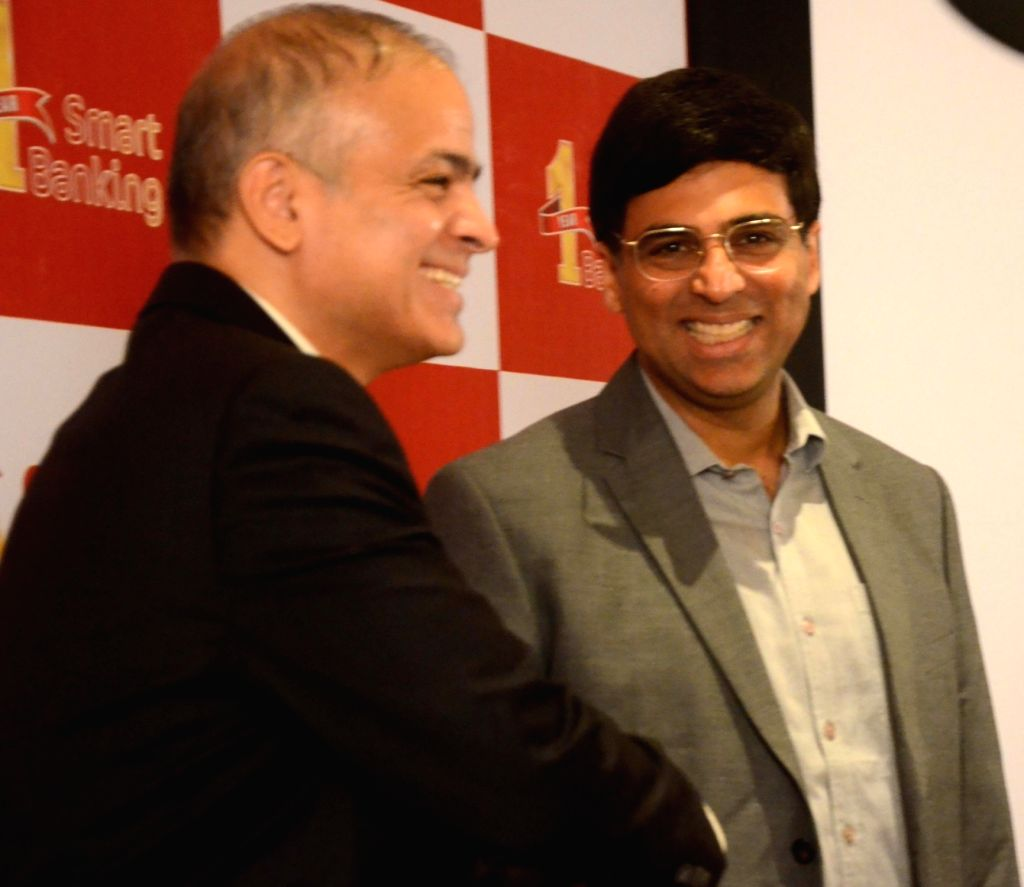 Fincare Small Finance Bank (Fincare SFB) CEO and MD with Chess player Rajeev Yadav and chess player and Fincare SFB Brand Ambassador Viswanathan Anand during a progrmme, in Mumbai on July 18, ... - Rajeev Yadav