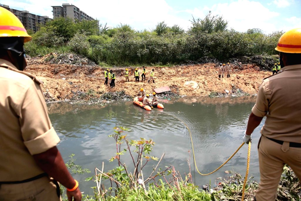 Fire and emergency personnel are engaged in search operations after a 6-year-old girl was washed away in an open drain in Bellandur, on July 11, 2020.