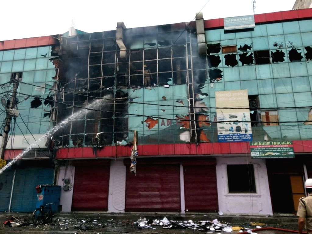 Fire at Azadpur's monestary, cooling operations underway.