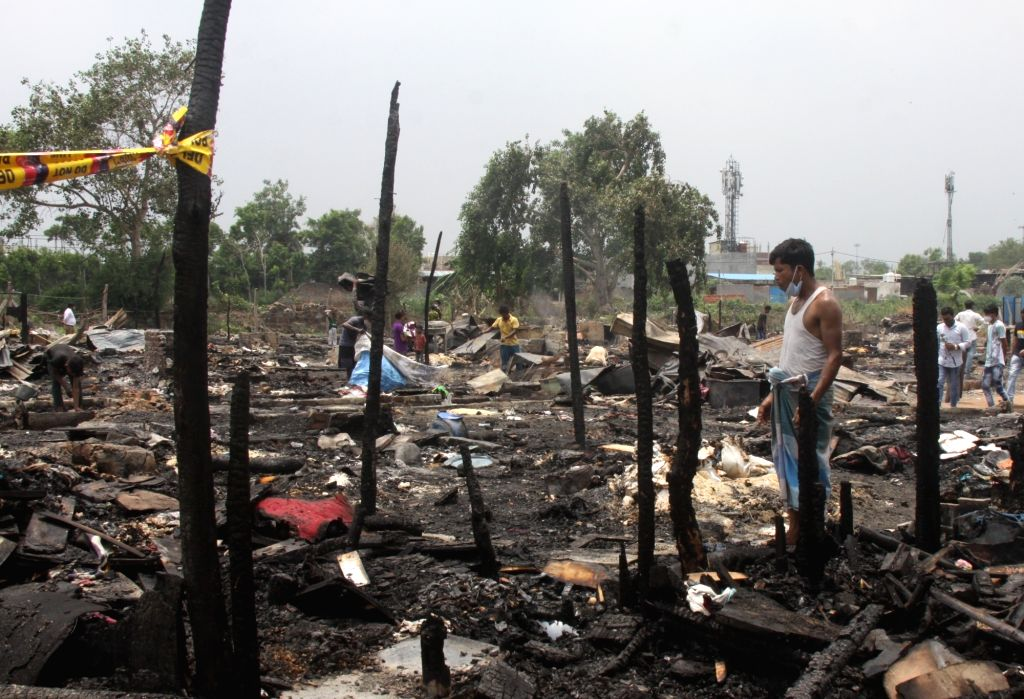 Fire at Rohingya camp in Delhi in Saturday night, many shanties burnt after a fire broke out at Madanpur khadar in New Delhi on Sunday June 13, 2021.