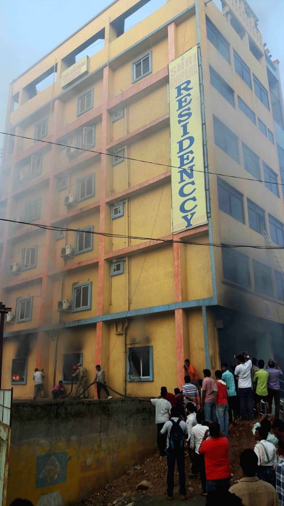 Fire breaks out at a eight-storey building of Anupama Residency lodge in Shamshabad on the outskirts of Hyderabad on June 14, 2017.