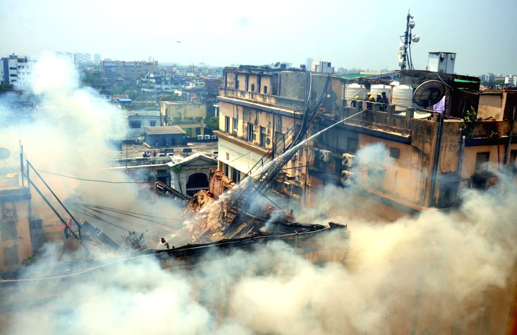 Fire breaks out at a four-storeyed building at South Kolkata's Chowringhee Road, on April 26, 2019. The fire broke out at around 9.20 a.m. and 12 engines have been deployed at the site.