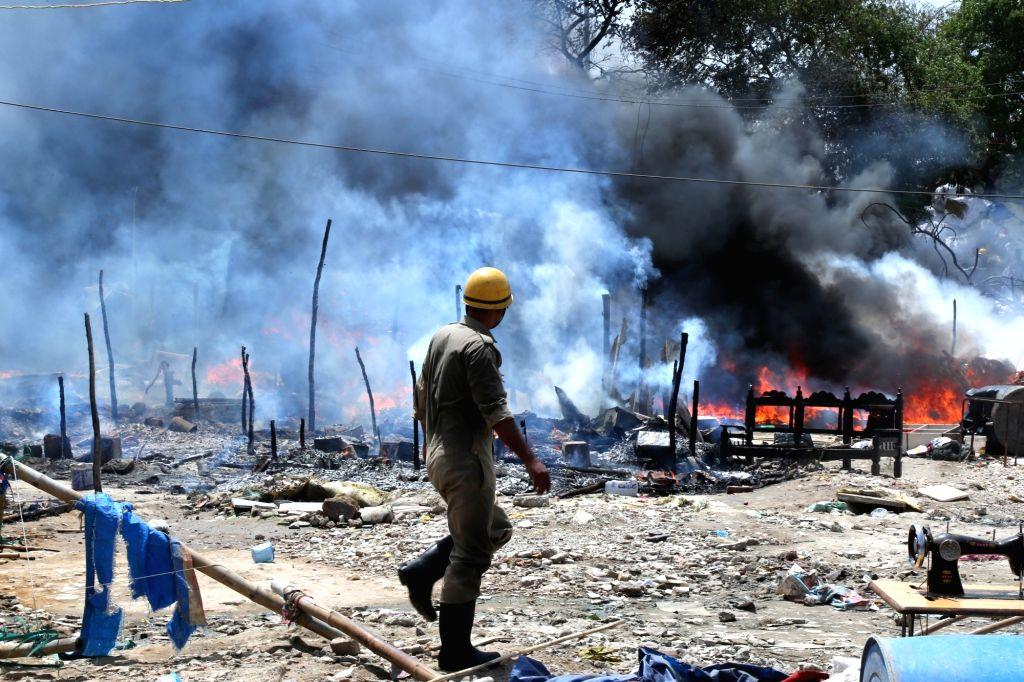 Fire breaks out at a slum in Laxmi Nagar area of New Delhi, on April 27, 2019.
