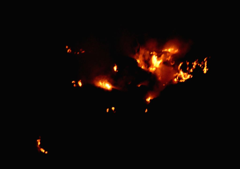 Fire breaks out at Ghazipur landfill in east Delhi on Oct 13, 2017.