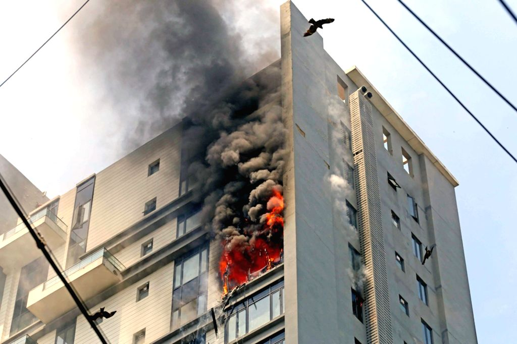 Fire breaks out at the 16th floor of a high-rise building amid nationwide lockdown imposed in the wake of COVID-19 pandemic, in Kolkata on March 30, 2020.